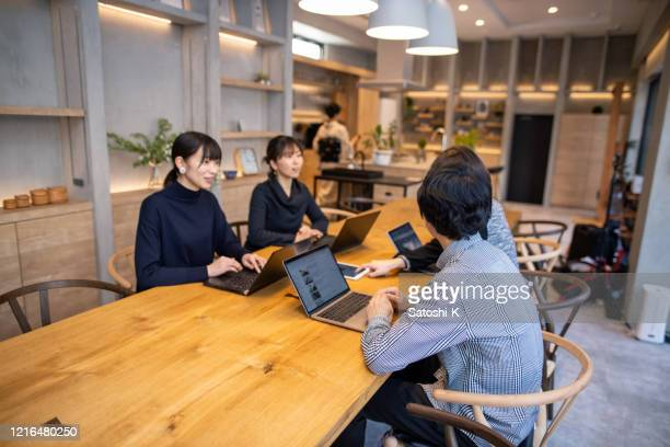 business people having discussion in comfortable meeting space - only japanese stock pictures, royalty-free photos & images