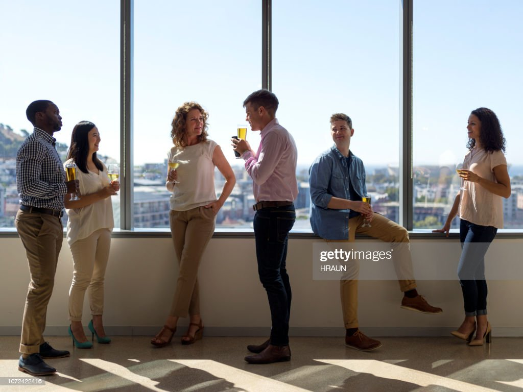 Business people having drinks after work. : Stock Photo