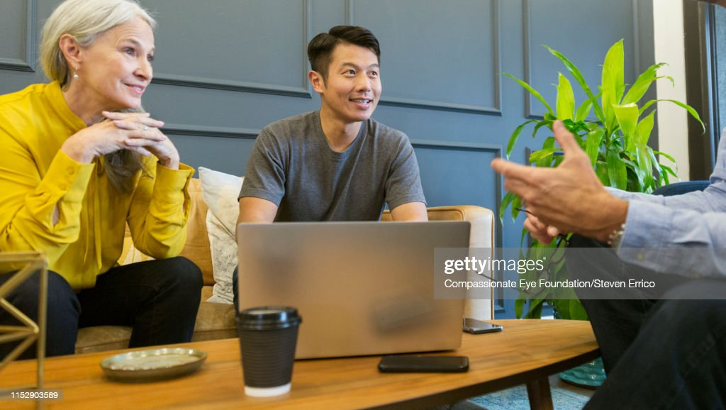 Business people having informal meeting in co-working space : Stock Photo