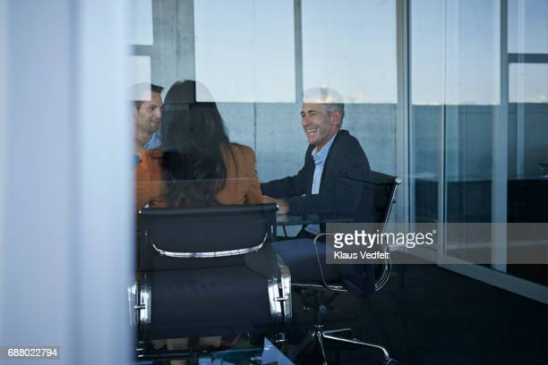 Business people having laughing in meeting room
