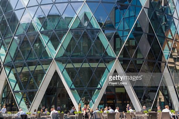 Business people having lunch break by the Gherkin Swiss Re Building