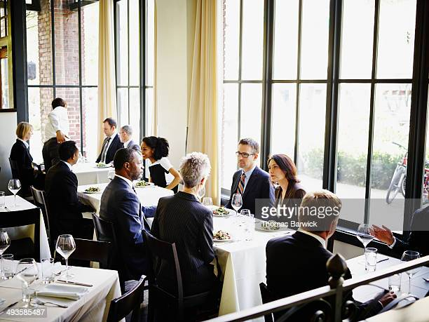 business people having lunch in restaurant - lunch foto e immagini stock