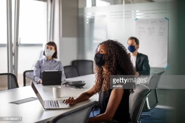 business people having meeting during pandemic - meeting stock pictures, royalty-free photos & images