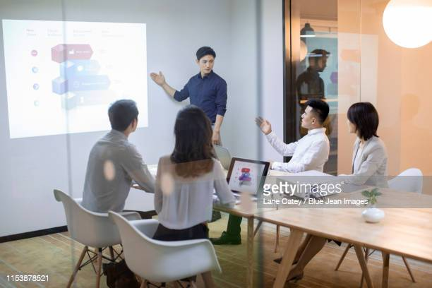 business people having meeting in board room - visual china group stock pictures, royalty-free photos & images