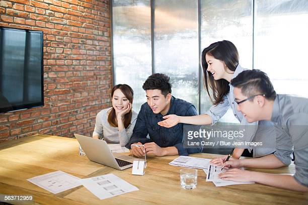 Business people having meeting in board room