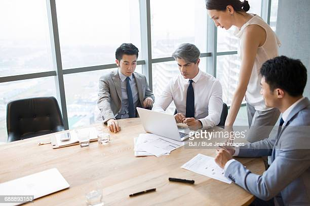 Business people having meeting in board room