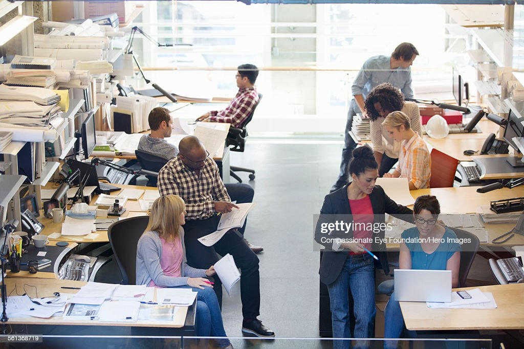 Business people having meeting in busy office : Stock Photo