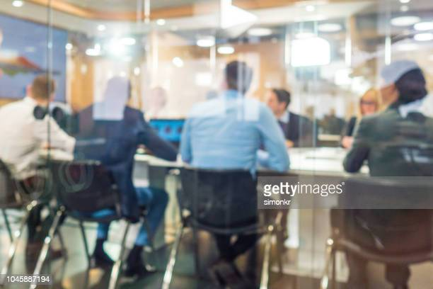 business people having meeting in conference room - soft focus stock pictures, royalty-free photos & images