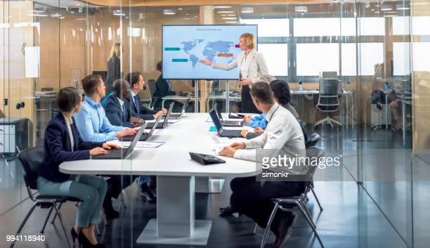 business people having meeting in conference room - gray jeans stock pictures, royalty-free photos & images