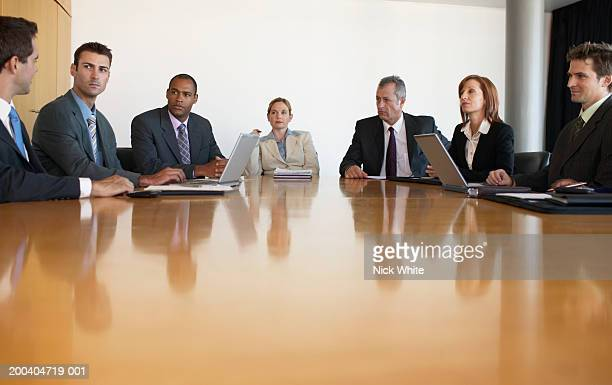Business people having meeting in conference room, view across table
