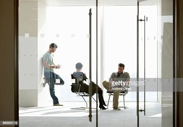 Business people having meeting in empty office