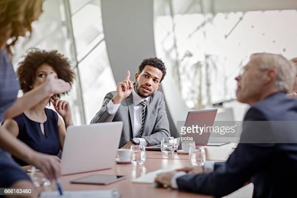 business people having meeting in modern in office