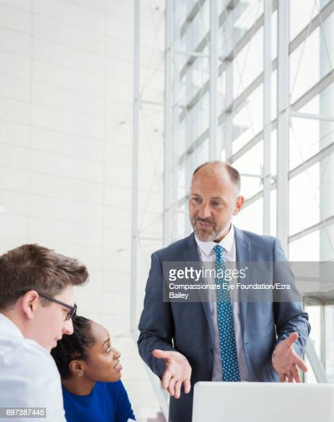 Business people having meeting in modern lobby