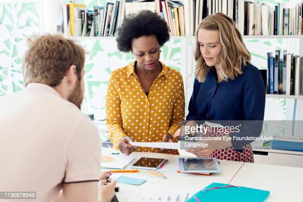 business people having meeting in modern office - vanguardians stock pictures, royalty-free photos & images