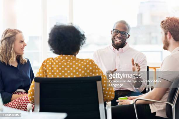 business people having meeting in modern office - small group of people stock pictures, royalty-free photos & images