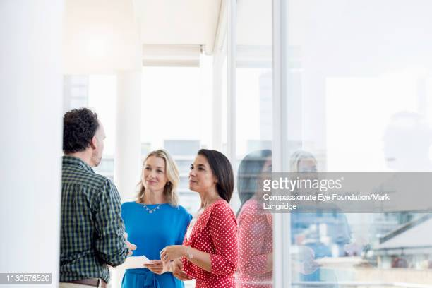 business people having meeting in modern office - talking stock pictures, royalty-free photos & images