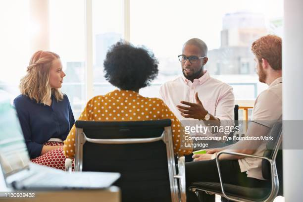 "business people having meeting in modern office - ""compassionate eye"" stock pictures, royalty-free photos & images"
