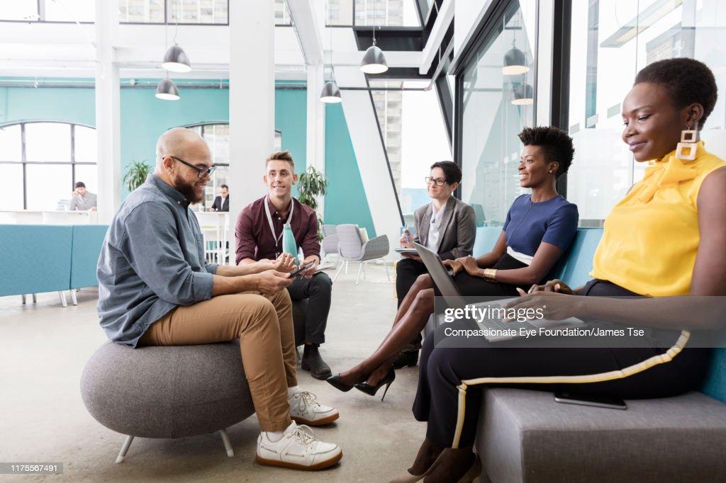 Business people having meeting in modern open plan office : Stock Photo