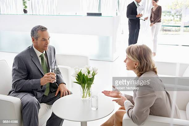 Business people having meeting in office lobby