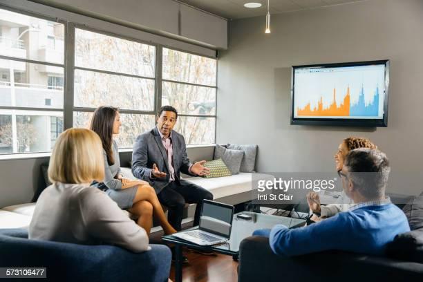 Business people having meeting in office lounge