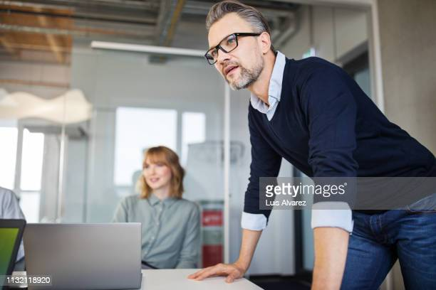 business people having meeting in office - concepts & topics stock pictures, royalty-free photos & images