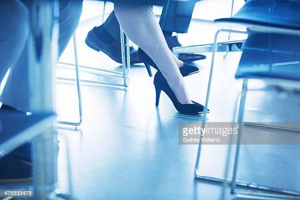 Business people having meeting, legs only