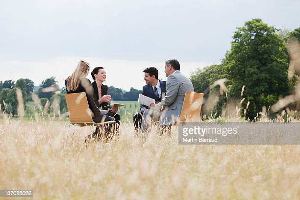 business people having meeting outdoors - landelijke scène stockfoto's en -beelden
