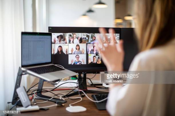 business people having online meeting - greeting stock pictures, royalty-free photos & images
