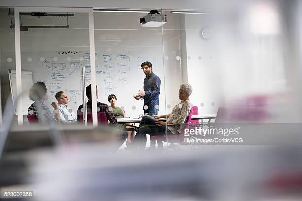 Business people having presentation in conference room using digital tablet