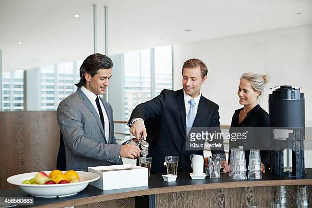 Business people having tea and coffee break