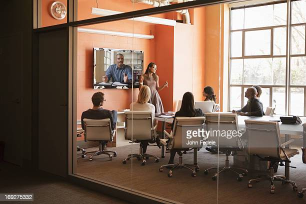 business people having teleconference in meeting - virtual meeting stock pictures, royalty-free photos & images