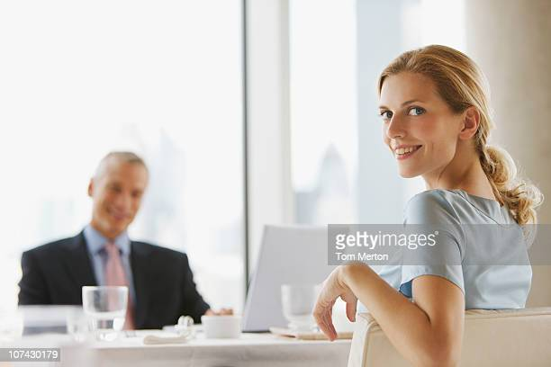 business people having working lunch in restaurant - turning stock pictures, royalty-free photos & images