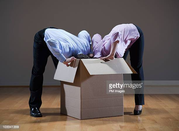Business people heads in a box