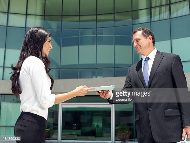 Business people holding a document