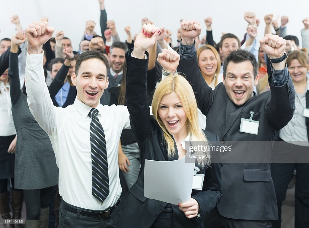 Business people holding fists up. : Stock Photo