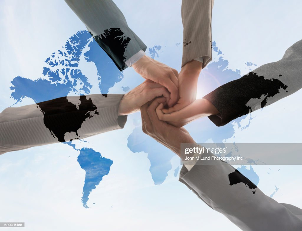 Business people holding hands in world map stock photo getty images business people holding hands in world map stock photo gumiabroncs Gallery