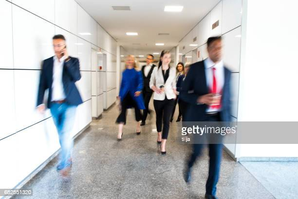 Business people in a blurred motion