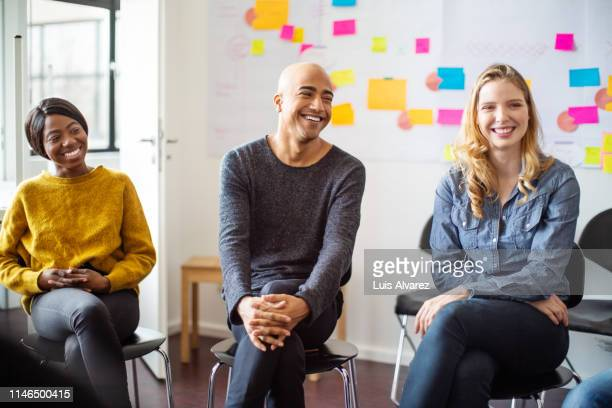 business people in a brainstorming meeting - learning objectives stock pictures, royalty-free photos & images