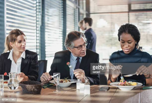 Business people in a cafe restaurant on a lunch break