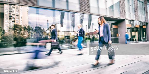 business people in a hurry to work - busy sidewalk stock pictures, royalty-free photos & images