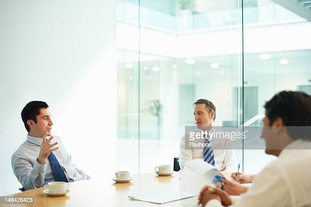 business people in a meeting - business meeting stock pictures, royalty-free photos & images