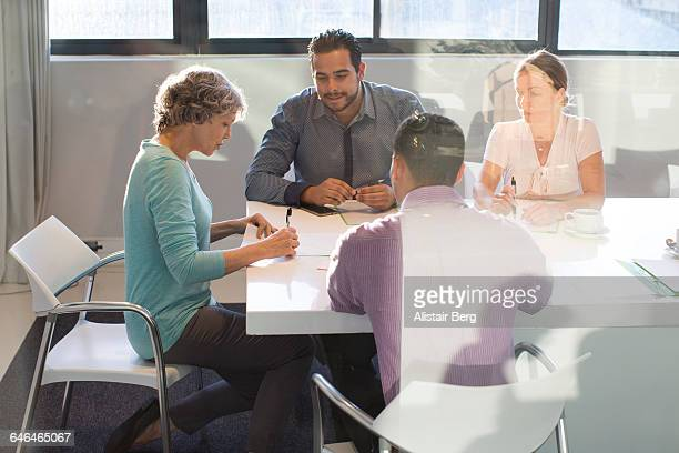business people in a meeting - vanguardians stock pictures, royalty-free photos & images