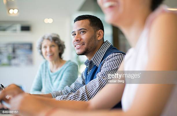 business people in a meeting - mid adult stock photos and pictures