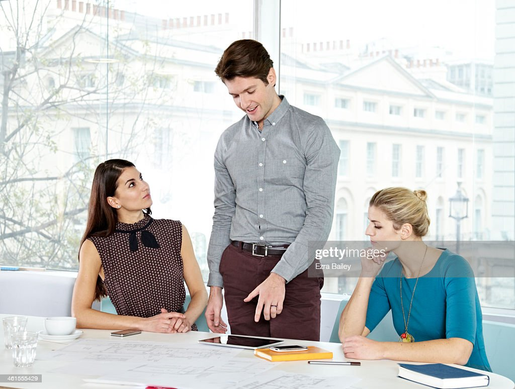 Business people in a modern office chatting. : Stock Photo