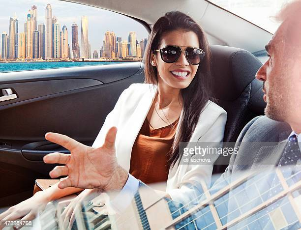 Business people in back seat of car in Dubai