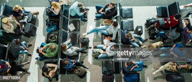 Business people in departure lounge