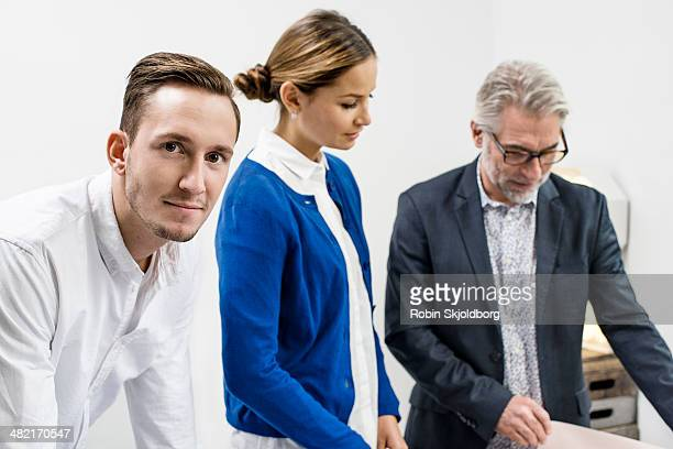 business people in discussion at office - robin skjoldborg stock pictures, royalty-free photos & images