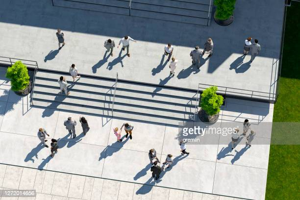 business people in front of office building - office park stock pictures, royalty-free photos & images
