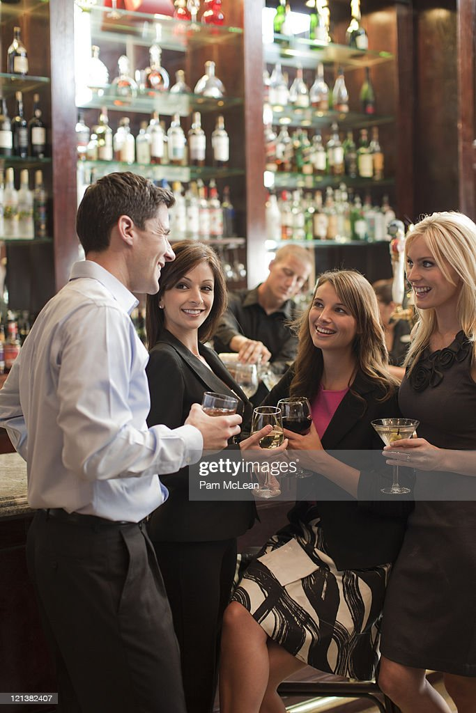 Business people in hotel bar : Stock Photo