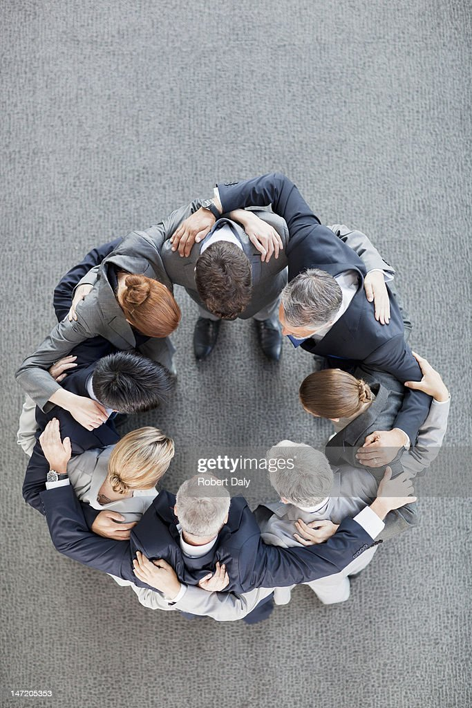 Business people in huddle : Stock Photo